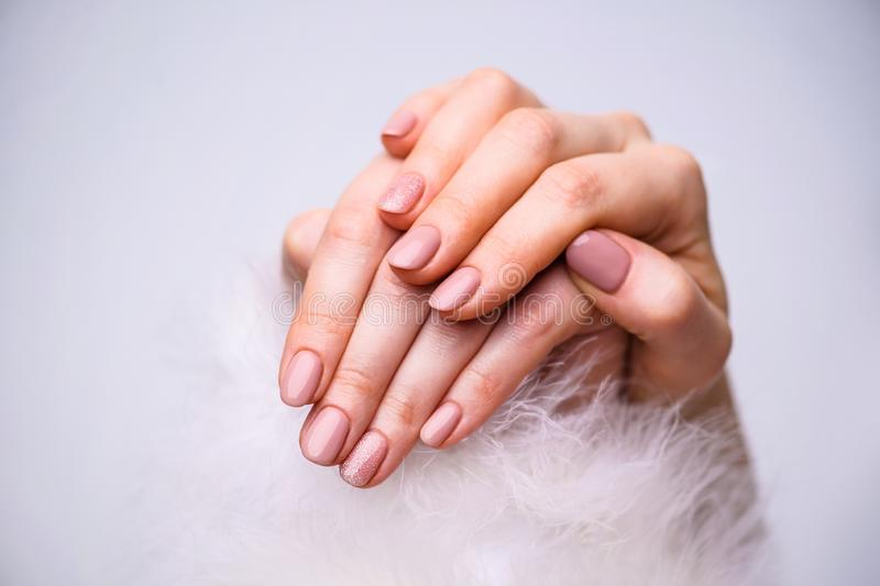 Nails Design. Hands With Bright Pink Spring Manicure On Grey Background. Close Up Of Female Hands. Art Nail stock photos