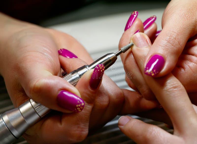 Nails polishing royalty free stock photography