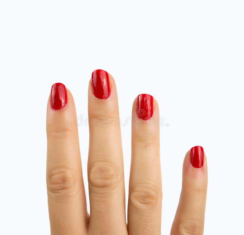 Nails of red polish stock photos