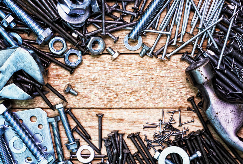 Nails and screws like a frame. stock images
