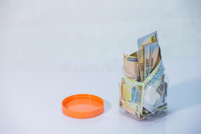 Naira notes in a glass jar - concept of Saving. Local currencies and Naira notes in a glass jar - concept of Saving stock photos