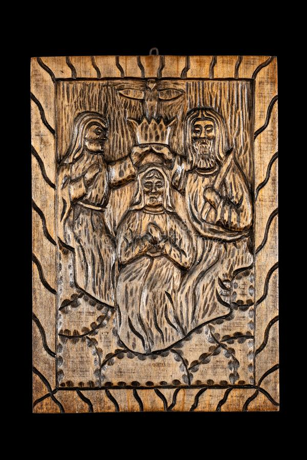 Coronation of the Virgin Naive Wood Bas Relief royalty free stock photo