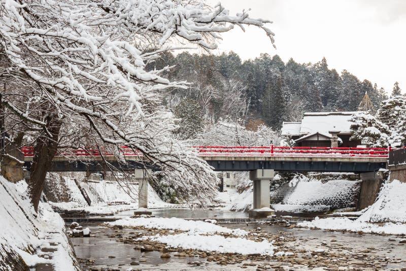 Nakabashi Bridge with snow fall and Miyakawa river in winter season . Landmark of Hida , Gifu , Takayama , Japan . Landscape view royalty free stock photography