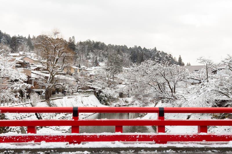 Nakabashi Bridge with snow fall and Miyakawa river in winter season . Landmark of Hida , Gifu , Takayama , Japan . Landscape view stock images