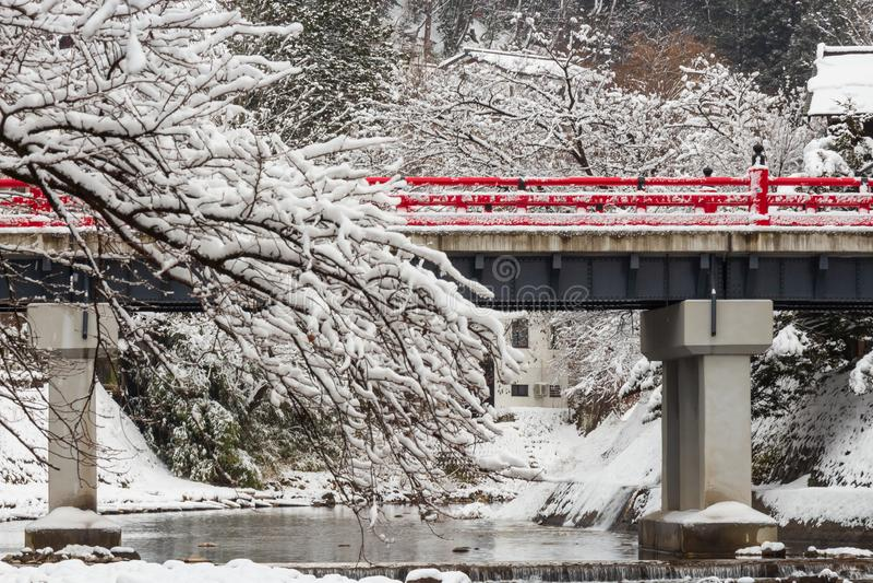 Nakabashi Bridge with snow fall and Miyakawa river in winter season . Landmark of Hida , Gifu , Takayama , Japan . Landscape view royalty free stock images