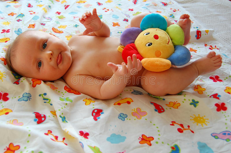 Naked baby. Boy with pretty flower stock photography