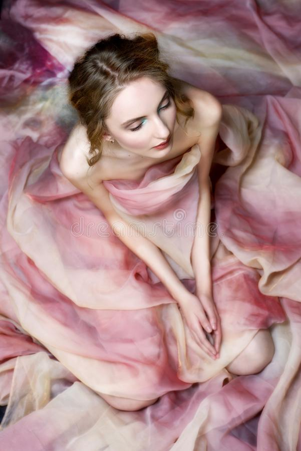 Naked beautiful woman draped in transparent dress. stock images
