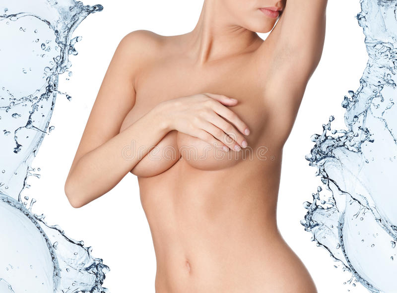 Naked body in water splash. Isolated on white royalty free stock images