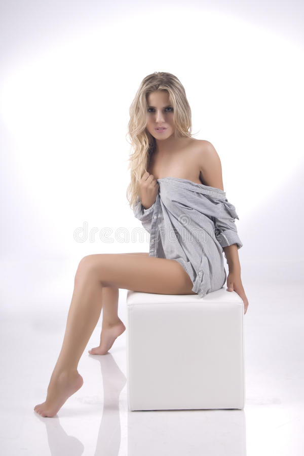Naked, emotional model on a gray background stock images