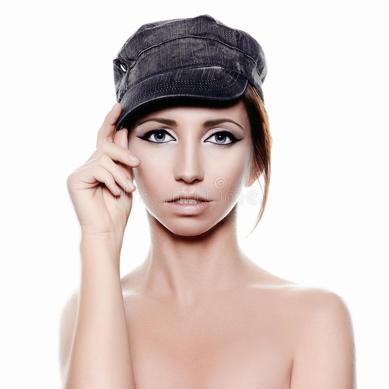 Naked Girl in Cap. beauty make-up woman stock photo
