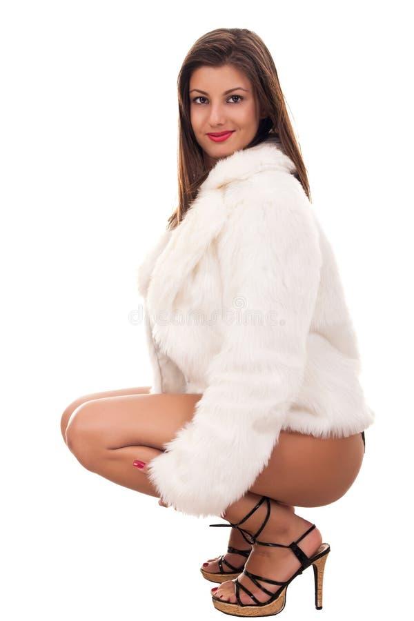 Naked girl wearing only fur coat