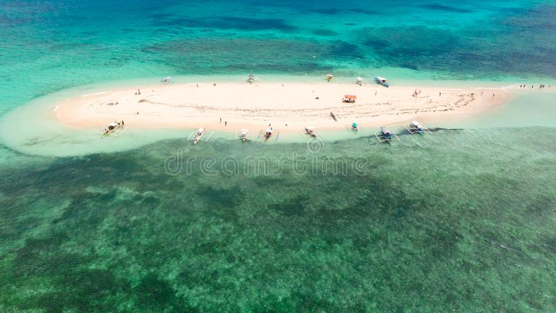 Naked Island, Siargao. The white sandy island is surrounded by a coral reef, a top view stock photo