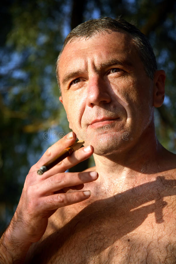 Download Naked man with a cigar stock photo. Image of cool, face - 15885828
