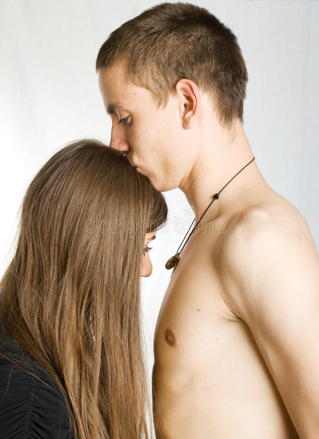 Naked man kissing woman royalty free stock image