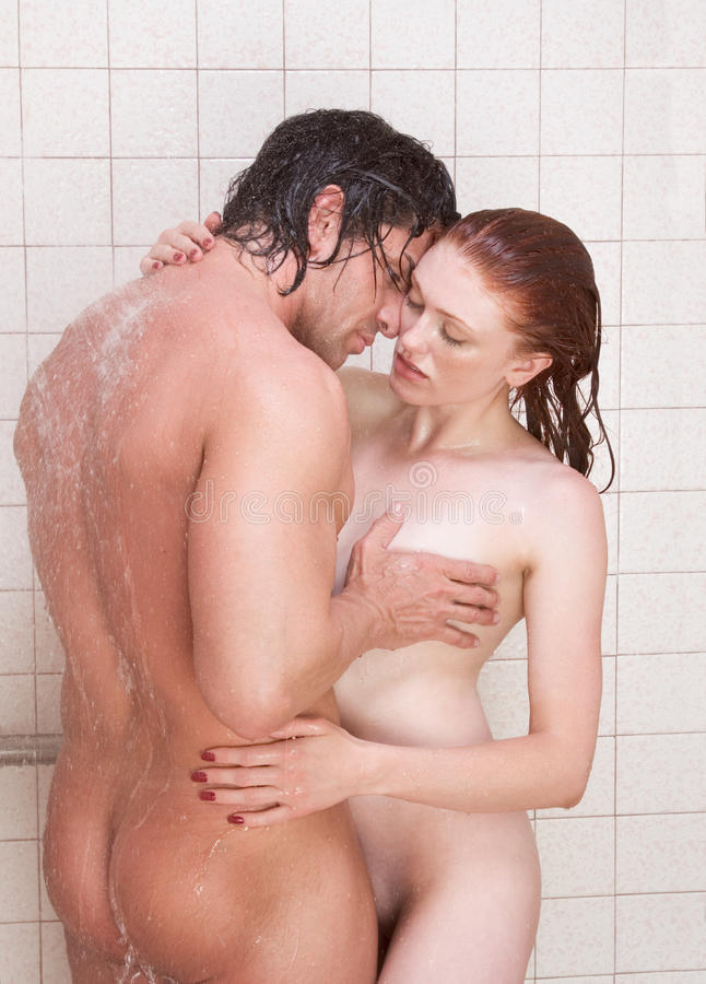 men and woman kissing naked