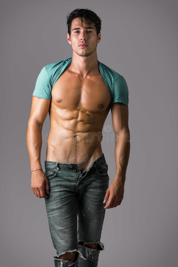 Free Naked Muscular Man Wearing Only Jeans Royalty Free Stock Image - 78950056