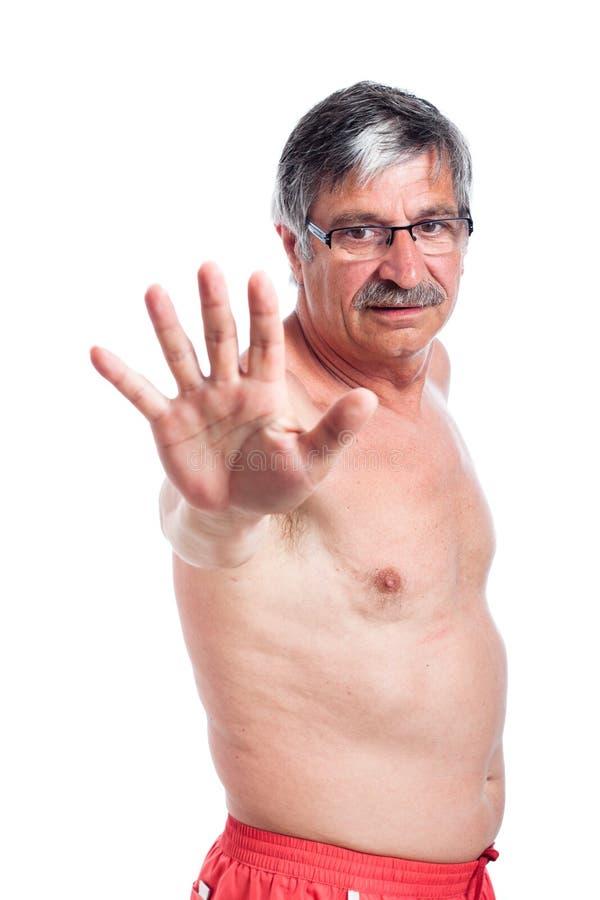 Naked senior man gesturing stop