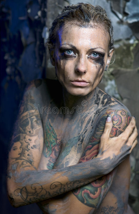 naked tattooed woman stock photo image of dirt breast