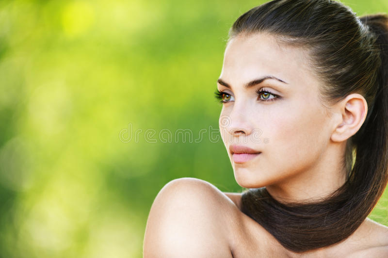 Naked woman beautiful dark-haired royalty free stock photography
