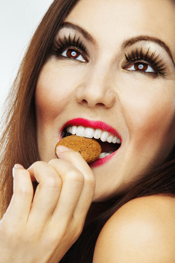 Download Naked woman biting biscuit stock image. Image of makeup - 21263077
