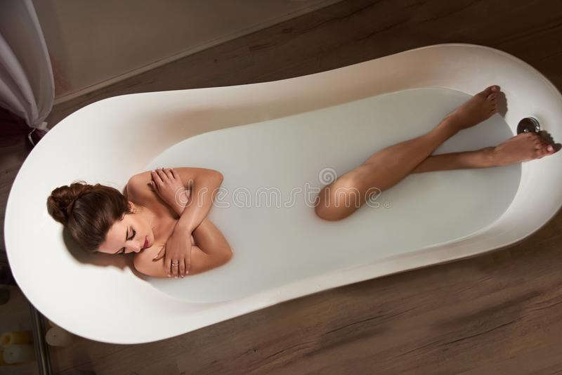 Woman in bath of milk royalty free stock images