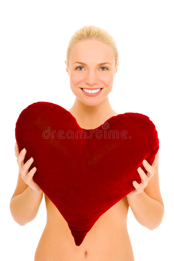 Naked woman with heart-shaped pillow royalty free stock photography