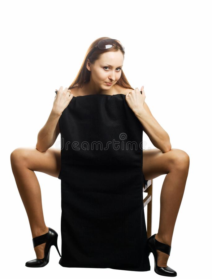 Naked woman sitting on the chair stock photos