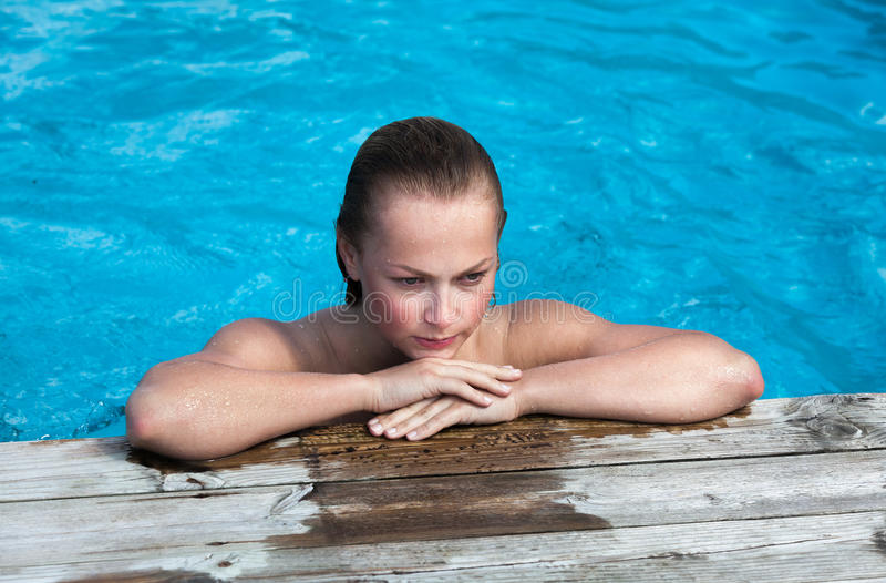 Naked woman in swimming pool royalty free stock photography
