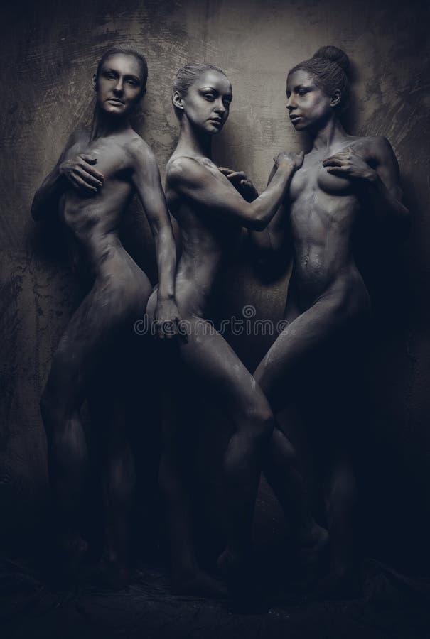 Naked women. With gray body-art royalty free stock photos