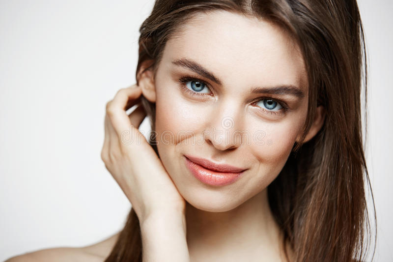 Naked young beautiful girl with natural make up smiling