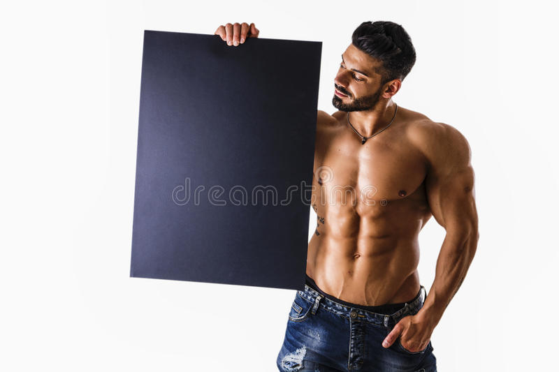 Pictures of Naked young male bodybuilder holding blank