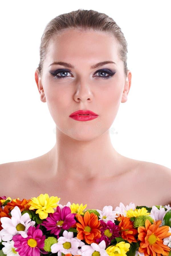 Naken kvinna med blommor royaltyfria foton
