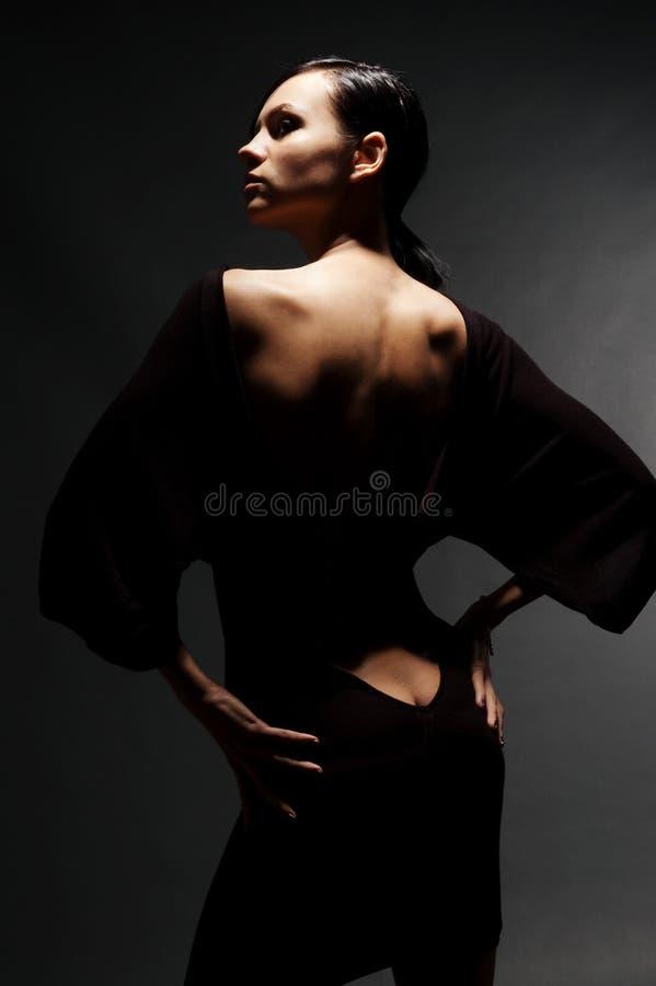 naken sexig kvinna för tillbaka klänning royaltyfri foto