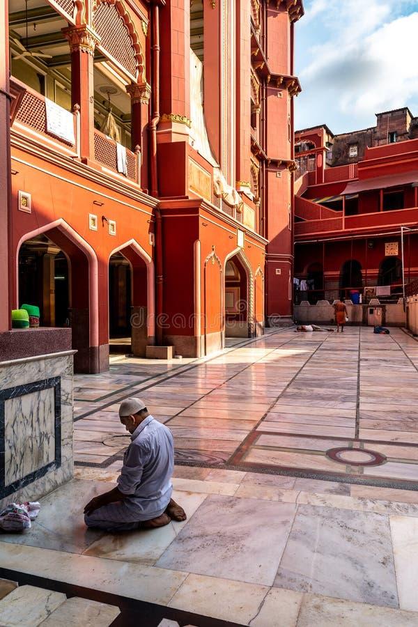 Nakhoda Masjid,the principal mosque of Kolkata. May 27,2018. Kolkata,India. An unidentified muslim man praying to Allah at Nakhoda Masjid,the principal mosque of royalty free stock images