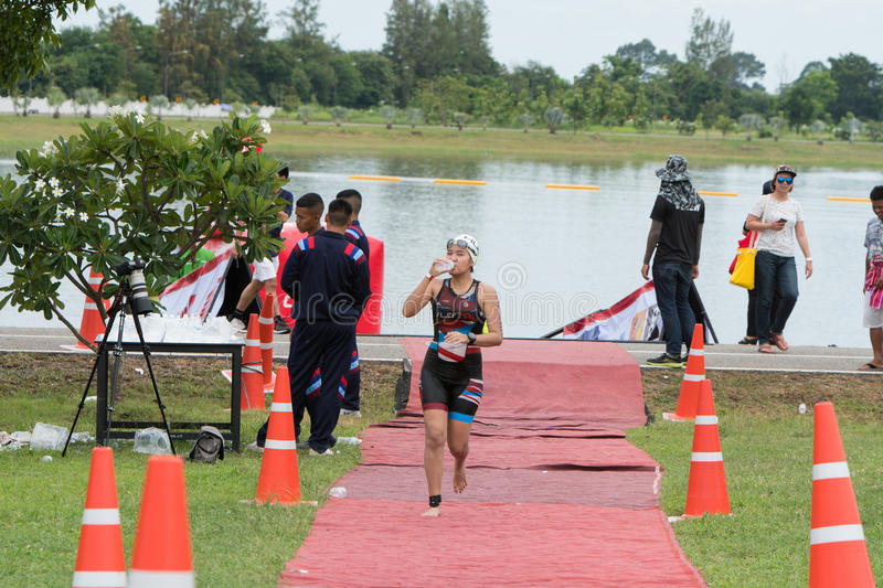 Nakhon nayok,Thailand - 25 June 2017: Woman swimmer run from poo. L to transition area in Challenge Nakhon Nayok 2017 stock images
