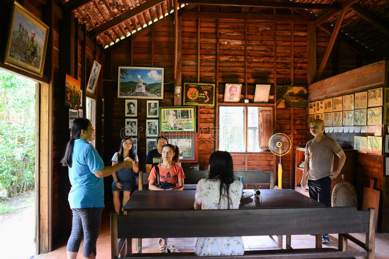 Nakhon Phanom, Thailand - Aug 11, 2018: Visitors listening to Ho Chi Minh`s memorial house. Owner describing about history, where young Ho Chi Minh lived durin stock images