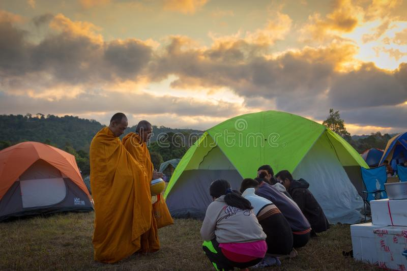 Nakhon Ratchasima,Thailand-December 31,2017:Morning sunrise,people come to relax on holiday,give alms to the monks,to make merit, stock image