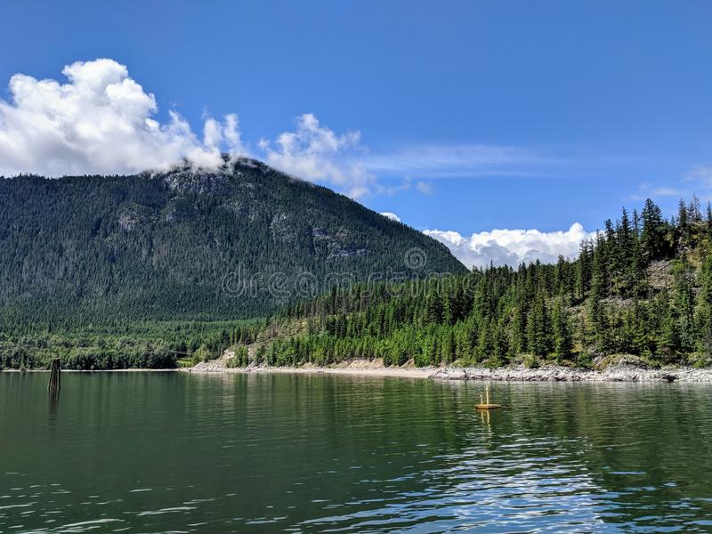 Nakusp. Travel, beautiful, nature, canada, lake, clouds, cloudy, mountain, trees royalty free stock images