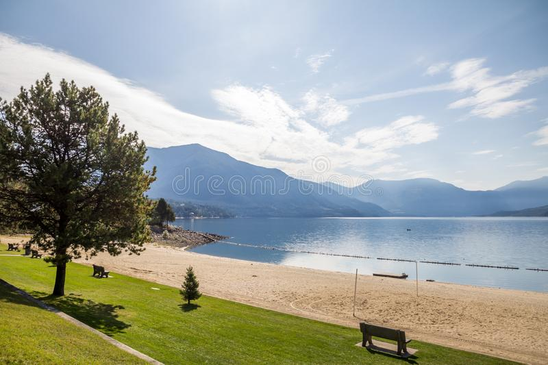 Nakusp waterfront and beach on Upper Arrow Lake, BC, Canada. Upper Arrow Lake - part of the Columbia River - and surrounding mountains from Nakusp beach in the royalty free stock photos