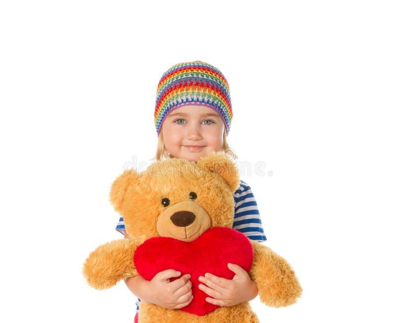 Nallebjörn och hjärta för liten flicka hållande arkivfoton
