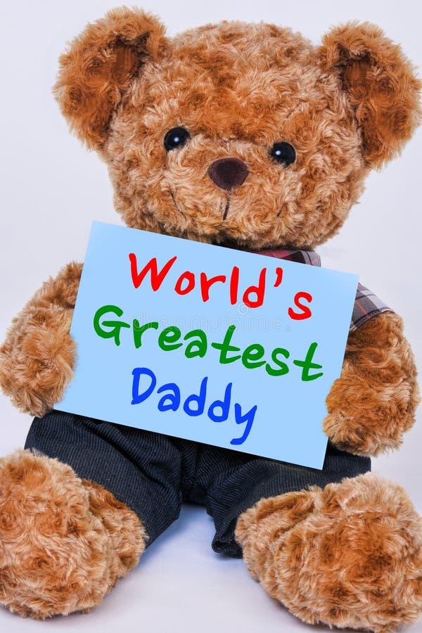 Nallebjörn som rymmer det blåa tecknet som säger den största farsan för världs` s royaltyfria foton