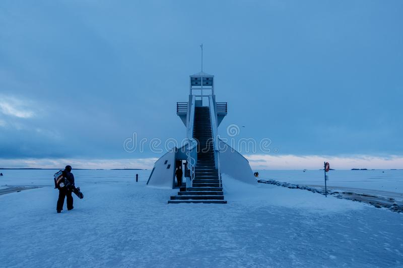 Nallikari Lighthouse in winter. Oulu, Finland Description: Nallikari Lighthouse in winter. Oulu, Finland. Evening view of Nallikari Lighthouse in winter. Oulu stock images