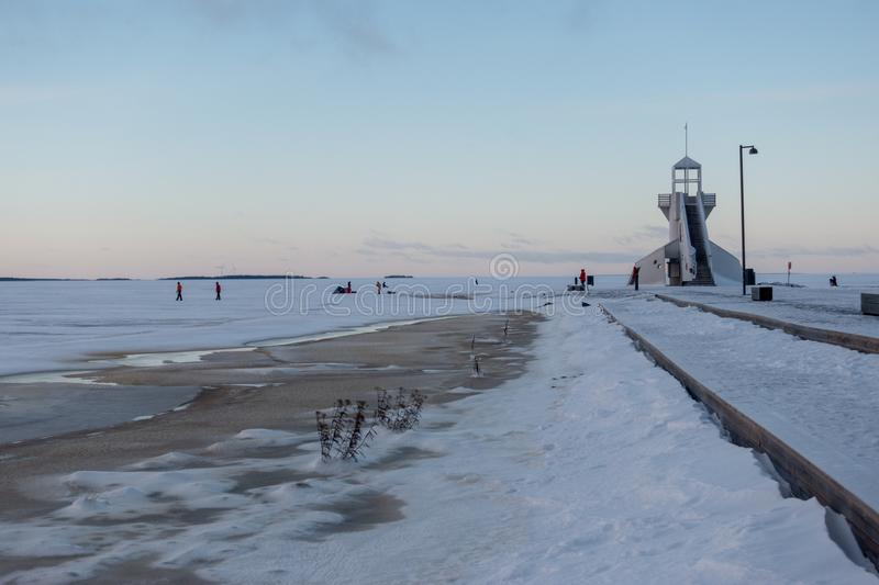 Nallikari Lighthouse in winter. Oulu, Finland. Evening view of Nallikari Lighthouse in winter. Oulu, Finland royalty free stock photo
