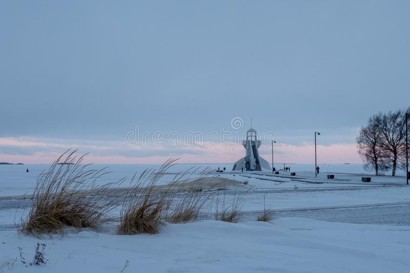 Nallikari Lighthouse in winter. Oulu, Finland. Evening view of Nallikari Lighthouse in winter. Oulu, Finland stock image