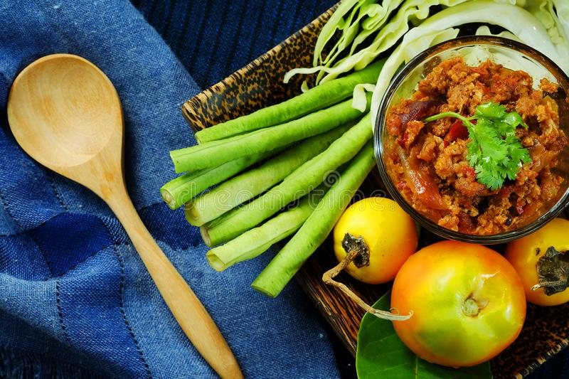 Northern Thai Meat and Tomato Spicy Dip or Thai Northern Style Chilli Paste Served fresh vegetable with flat lay v stock image