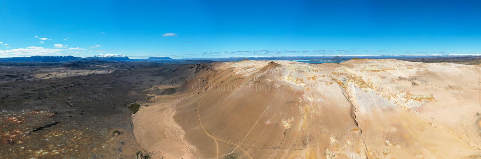 Namafjall Hverir geothermal area in Iceland. Stunning landscape of sulfur valley, panoramic view of Namafjall mountain and blue. Cloudy sky, travel background royalty free stock images
