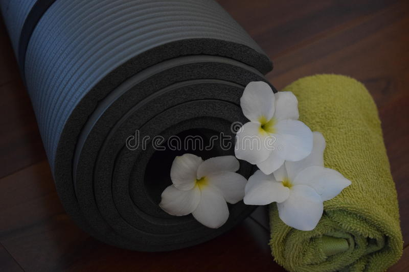 Namaste 2. Yoga equipment: a mat and a towel. The end of the yoga session concludes with a gesture and the word Namaste. Representing a belief that there is a royalty free stock photography