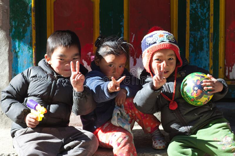 Nepalese children poses for a photo on the street. NAMCHE BAZAAR, NEPAL - JANUARY 19, 2017: Nepalese children poses for a photo on the street royalty free stock images