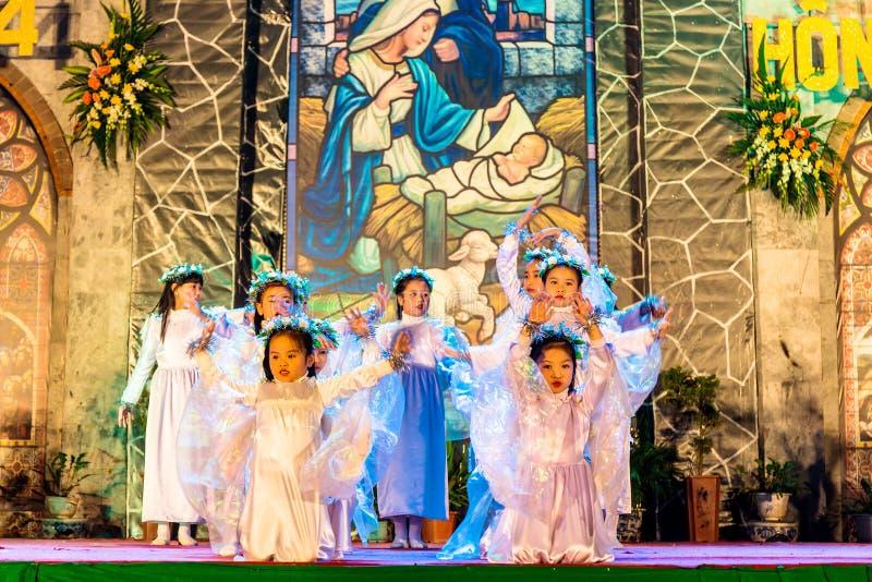 NAMDINH CITY, VIETNAM - DECEMBER 24, 2014 - Christian believers singing a Christmas carol on Christmas Eve stock image
