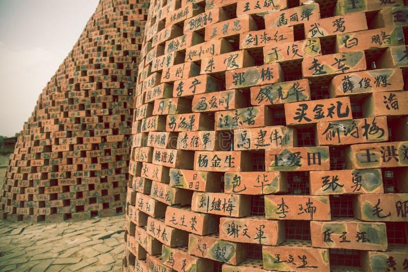 Name des chinesischen Volks geschrieben auf die Wand stockbild